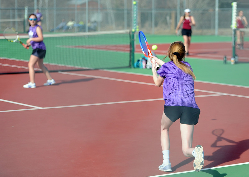 Rylynn Nealy sends a backhand back while teammate Valentina Vigil watches during the No. 2 doubles match at BHS courts on Thursday, March 28. Berthoud won 7-0. (Colin Barnard/Loveland Reporter-Herald)