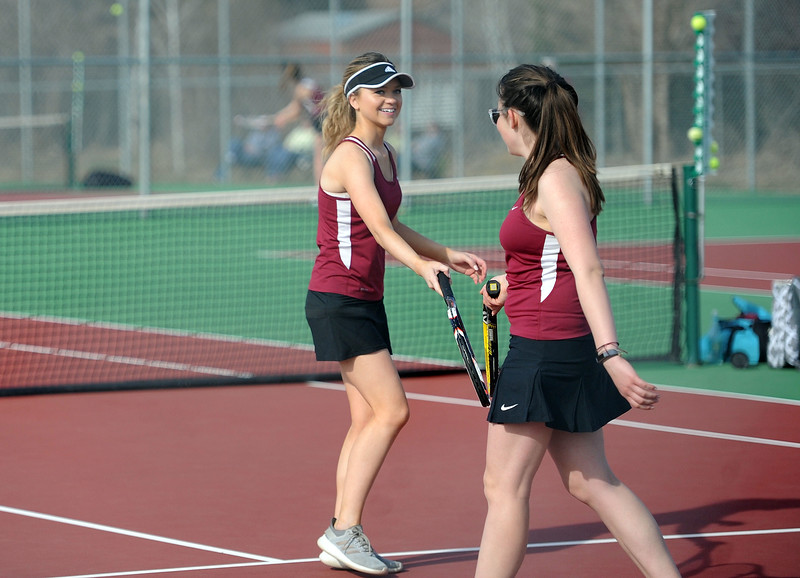 Lily Lind, left, and Alana Hymel celebrate a point during the No. 2 doubles match at BHS courts on Thursday, March 28. Berthoud won 7-0. (Colin Barnard/Loveland Reporter-Herald)