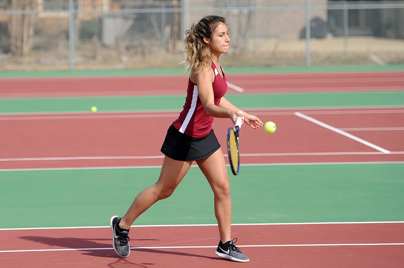 Eriana Rennaker connects on a forehand during her No. 1 singles match against Mountain View at BHS courts on Thursday, March 28. Berthoud won 7-0. (Colin Barnard/Loveland Reporter-Herald)
