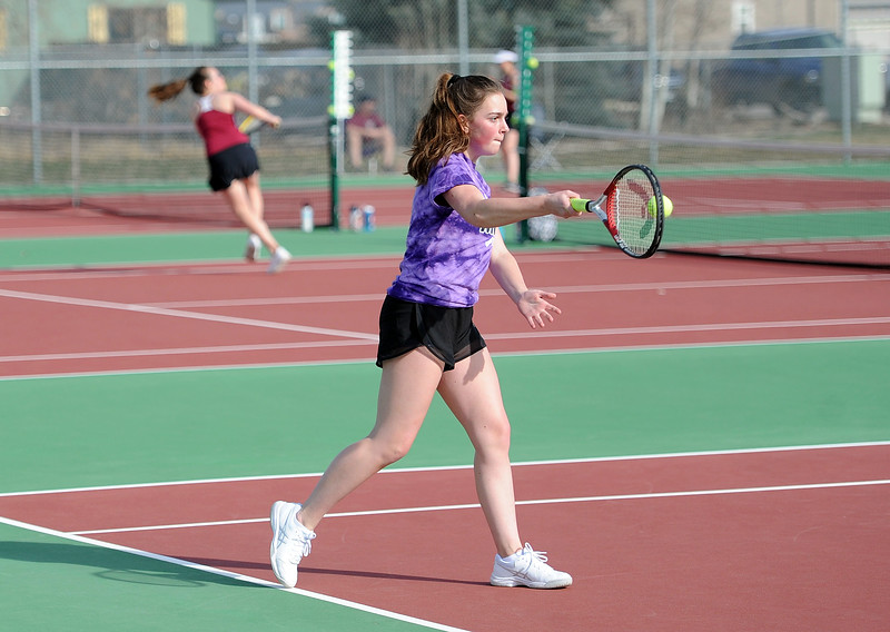 Hope Brown stares down a forehand during her No. 1 doubles match at BHS courts on Thursday, March 28. Berthoud won 7-0. (Colin Barnard/Loveland Reporter-Herald)