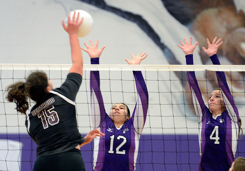 Berthoud's Kailey Berry spikes the ball as Mountain View's Rebecca Valdez, center, and Kara Benner, right, block during their game Friday, Nov. 4, 2016, at Mountain View High School in Loveland. (Photo by Jenny Sparks/Loveland Reporter-Herald)