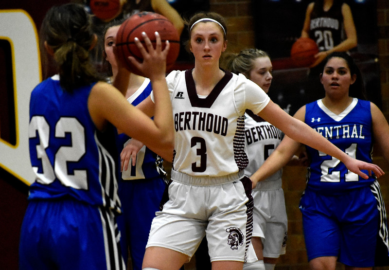 Berthoud's (3) Emily Cavey puts up a block against (32) Makenzie Mehess during their game on Tuesday, Feb. 20, 2018 at Berthoud High School in Berthoud. Photo by Thieng Mai/Loveland Reporter-Herald.
