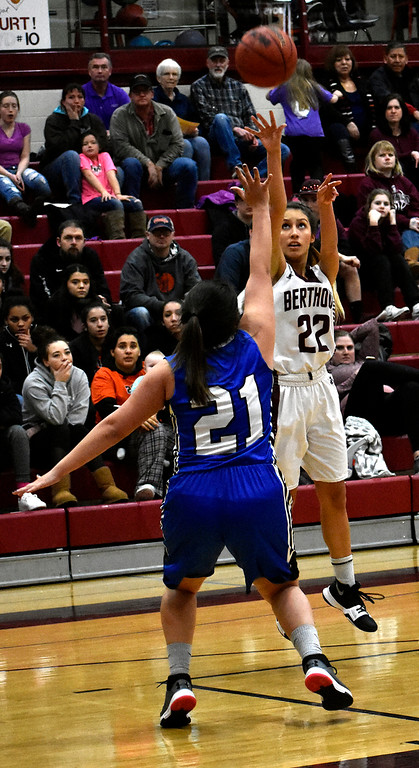 . Berthoud\'s (22) Eriana Rennaker goes for a three-point shot over Pueblo\'s (21) Sydney Zegarelli during their game on Tuesday, Feb. 20, 2018 at Berthoud High School in Berthoud. Photo by Thieng Mai/Loveland Reporter-Herald.
