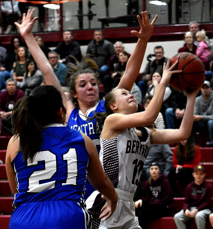 . Berthoud\'s (13) Breanna Fowler finds an opening for a shot between Pueblo\'s (21) Syney Zegarelli and (20) Alicia Lest\'s defenses during their game on Tuesday, Feb. 20, 2018 at Berthoud High School in Berthoud. Photo by Thieng Mai/Loveland Reporter-Herald.