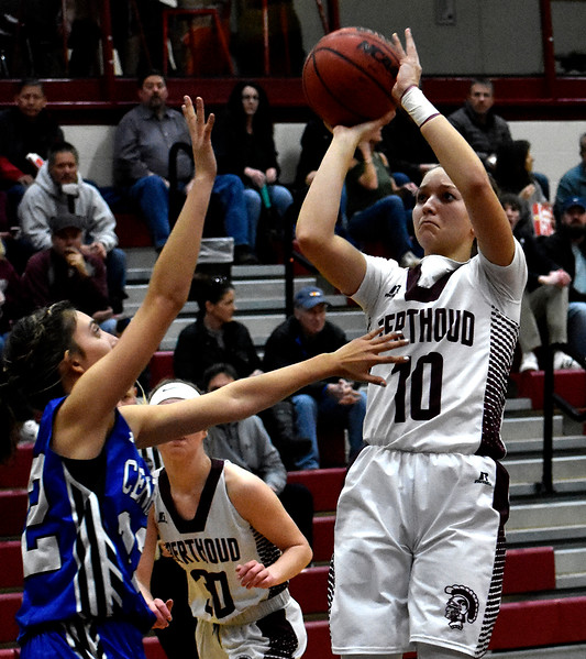 Berthoud's (10) Sydney Meis attempts a jump shot over Pueblo's (32) Makenzie Mehess during their game on Tuesday, Feb. 20, 2018 at Berthoud High School in Berthoud. Photo by Thieng Mai/Loveland Reporter-Herald.