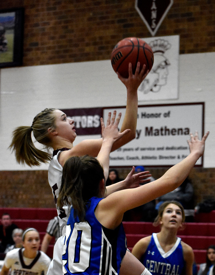 Berthoud's (5) Logan Davidson goes for an open shot before Pueblo's (20) Alicia Lest can stop her during their game on Tuesday, Feb. 20, 2018 at Berthoud High School in Berthoud. Photo by Thieng Mai/Loveland Reporter-Herald.