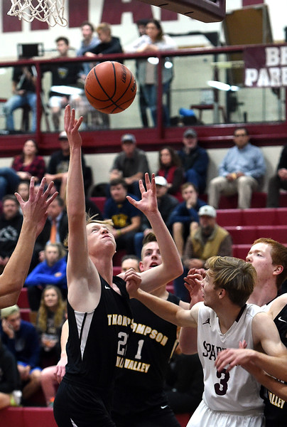 Thompson Valley's Matthew Lessman reaches for a rebound during their game against Berthoud Thursday, Dec. 20, 2018, at Berthoud High School. (Photo by Jenny Sparks/Loveland Reporter-Herald)