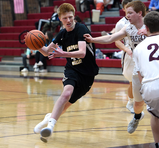 Thompson Valley's Jaromy Morgan takes the ball down court during their game against Berthoud Thursday, Dec. 20, 2018, at Berthoud High School. (Photo by Jenny Sparks/Loveland Reporter-Herald)