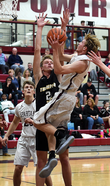 Berthoud's Curtis Peacock goes up for a shot as Thompson Valley's Jacob Brouwer tries to block during their game Thursday, Dec. 20, 2018, at Berthoud High School. (Photo by Jenny Sparks/Loveland Reporter-Herald)