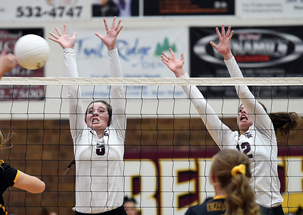 . Berthoud\'s (5) Taylor Whittet and (12) Teagan Holmes try to block the ball during their game against Thompson Valley Monday, Aug. 27, 2018, at Berthoud High School. (Photo by Jenny Sparks/Loveland Reporter-Herald)