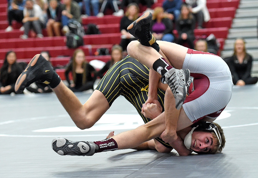 . Thompson Valley\'s Airiel Siegal wrestles Berthoud\'s Colton Williams during their 120 pound match Thursday, Nov. 29, 2018, at Berthoud High School.  (Photo by Jenny Sparks/Loveland Reporter-Herald)