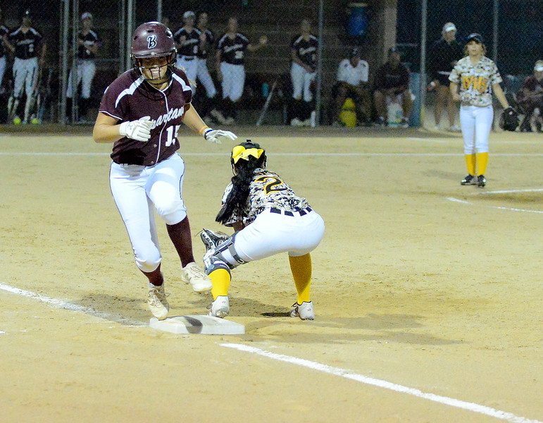 Thompson Valley first baseman Sierra Ortiz comes up with a low throw to nip Berthoud's Addison Spears at first base in Monday's game at Bein Park. (Mike Brohard/Loveland Reporter-Herald)