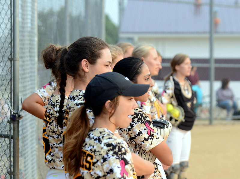 Thompson Valley's team watches as Berthoud takes infield prior to Monday's game at Bein Park in  Berthoud. (Mike Brohard/Loveland Reporter-Herald)