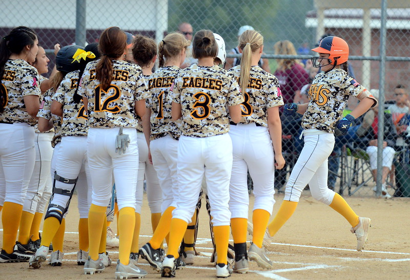 Thompson Valley's McKenna McVay is greeted at the plate by her teammates after leading off Monday's game with Berthoud with a home run. (Mike Brohard/Loveland Reporter-Herald)