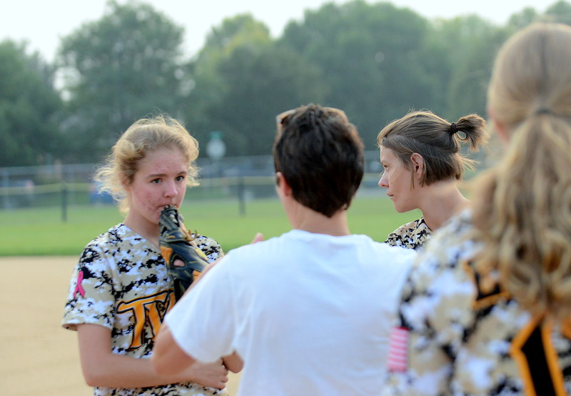 Thompson Valley assistant coach Amanda Rutherford talks to the outfielders about situations prior to Monday's game with Berthoud at Bein Park in Berthoud. (Mike Brohard/Loveland Reporter-Herald)