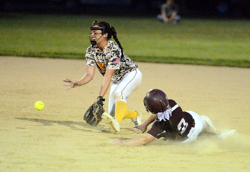 Thompson Valley shortstop McKenna McVay tries to come up with the short hop as Berthoud's Mandi Laib slides in with a stolen base in Monday's game at Bein Park. (Mike Brohard/Loveland Reporter-Herald)