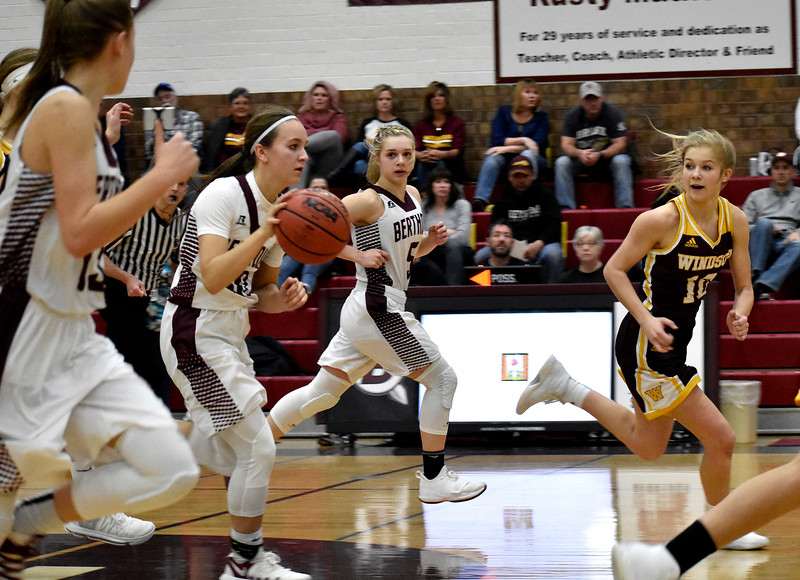 Berthoud's (5) Logan Davidson and Windsor's (10) Hollie Hoffman keep their eyes on the ball during their game on Friday, Jan. 19, 2018 at Berthoud High School in Berthoud. Photo by Thieng Mai.