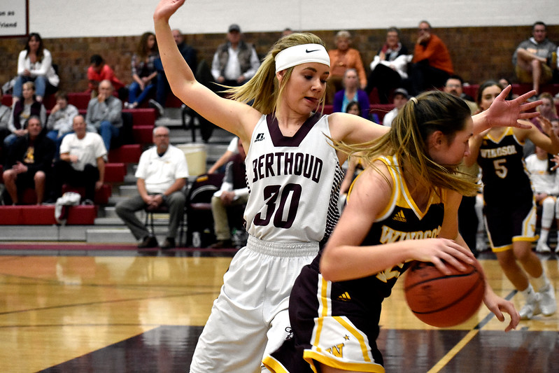 Berthoud's (30) Ashlee Burdette throws out an arm to block Windsor's (12) Karly Mathern during their game Friday, Jan. 19, 2018 at Berthoud High School in Berthoud. (Photo by Thieng Mai/Loveland Reporter-Herald)