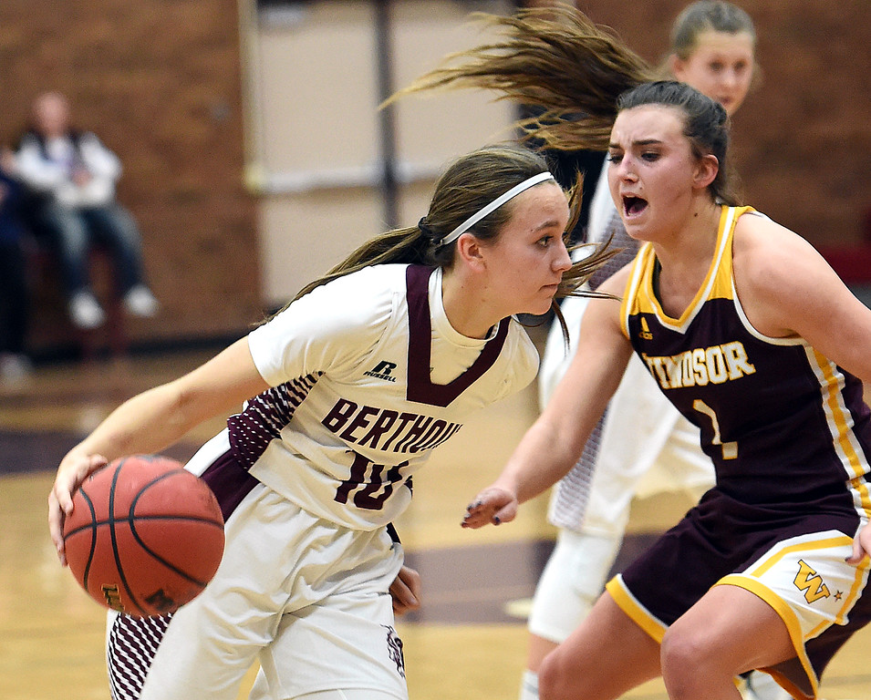 Berthoud's (10) Sydney Meis takes the ball downcourt past Windsor's (2) Karee Porth during their game  on Friday, Jan. 19, 2018, at Berthoud High School. (Photo by Jenny Sparks/Loveland Reporter-Herald)