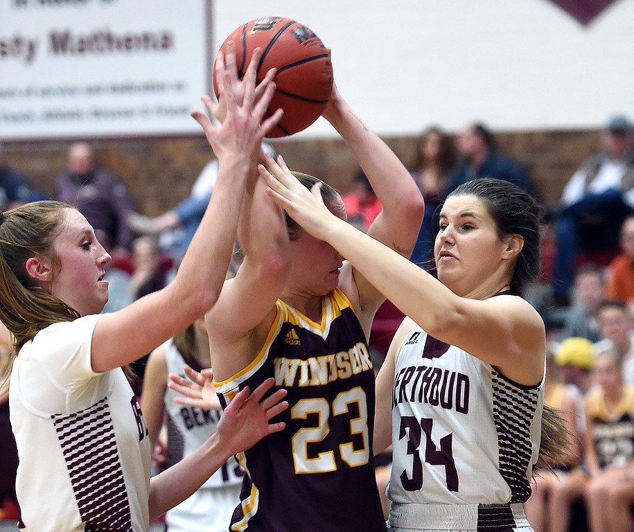 Berthoud's (3) Emily Cavey and (34) Celsey Selland try to get control of the ball from Windsor's (23) Madi Denzel during their game  on Friday, Jan. 19, 2018, at Berthoud High School. (Photo by Jenny Sparks/Loveland Reporter-Herald)