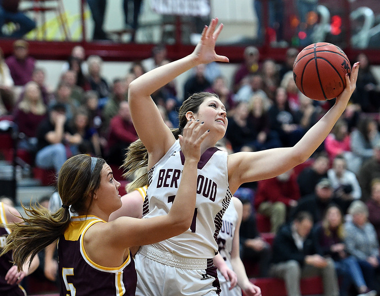 Berthoud's (14) Maddie Decker and Windsor's (5) Ally Kennis go up for a rebound during their game on Friday, Jan. 19, 2018, at Berthoud High School. (Photo by Jenny Sparks/Loveland Reporter-Herald)