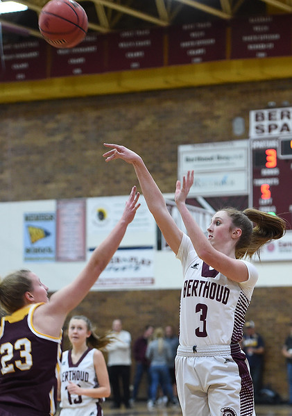 Berthoud's (3) Emily Cavey shoots a three-pointer as Windsor's (23) Madi Denzel tries to block during their game  on Friday, Jan. 19, 2018, at Berthoud High School. (Photo by Jenny Sparks/Loveland Reporter-Herald)