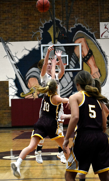 Berthoud's (3) Emily Cavey attempts a shot at the 3-point line before Windsor's (10) Hollie Hoffman can steal the ball during their game on Friday, Jan. 19, 2018 at Berthoud High School in Berthoud. Photo by Thieng Mai.