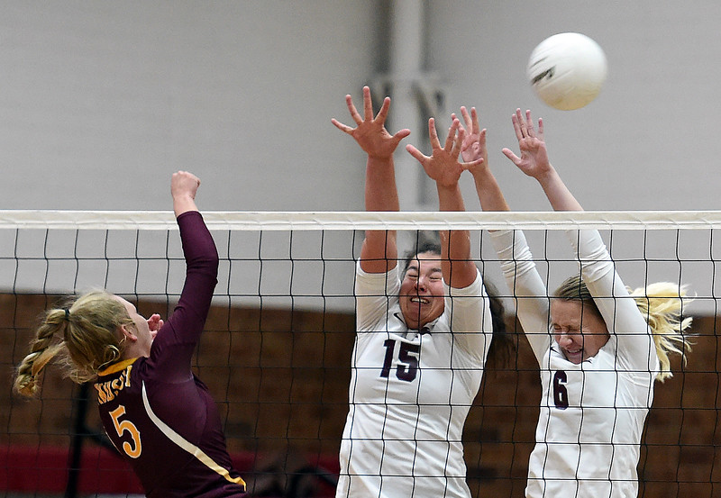 Berthoud's (15) Kailey Berry, left, and (6) Abi Lutz try to block a spike by Windsor's (5) Rylee Greiman during their game Tuesday, Oct. 24, 2017, at Berthoud High School in Berthoud.  (Photo by Jenny Sparks/Loveland Reporter-Herald)