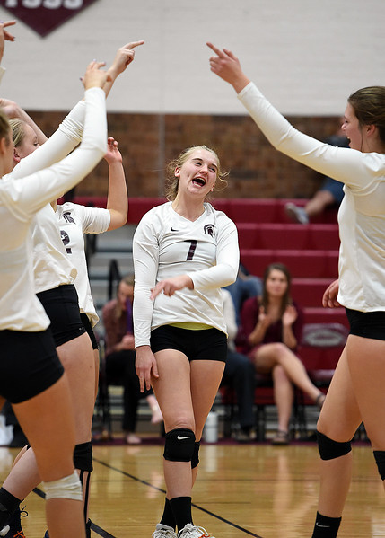 Berthoud volleyball players celebrate a point during their game against Windsor Tuesday, Oct. 24, 2017, at Berthoud High School in Berthoud.  (Photo by Jenny Sparks/Loveland Reporter-Herald)
