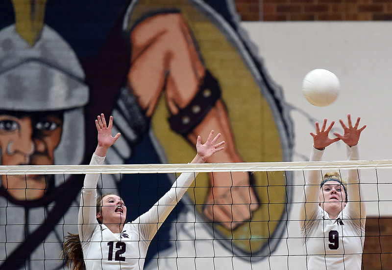 Berthoud's (12) Teagan Holmes, left, and (9) Julie Ward block the ball during their game against Windsor on Tuesday, Oct. 24, 2017, at Berthoud High School in Berthoud.  (Photo by Jenny Sparks/Loveland Reporter-Herald)