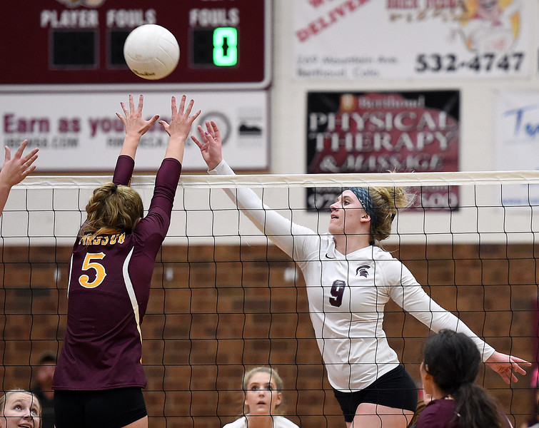Berthoud's (9) Julie Ward tips the ball over the net as Windsor's (5) Rylee Greiman tries to block during their game Tuesday, Oct. 24, 2017, at Berthoud High School in Berthoud.  (Photo by Jenny Sparks/Loveland Reporter-Herald)