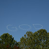 "the skywriter wrote ""love god"""
