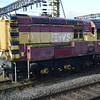Stored 08709 sits next to the station at Bescot