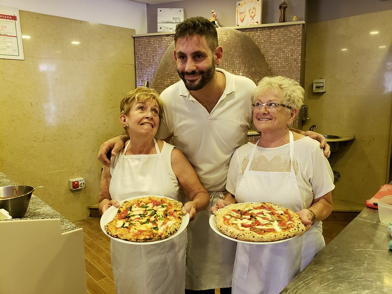 You can tell Lois and Joyce are really taken with their pizzas!