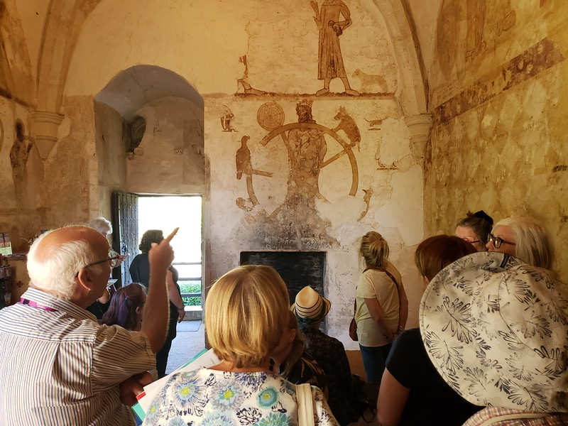Admiring the remarkable, 14th-century domestic wall paintings at Longthorpe Tower