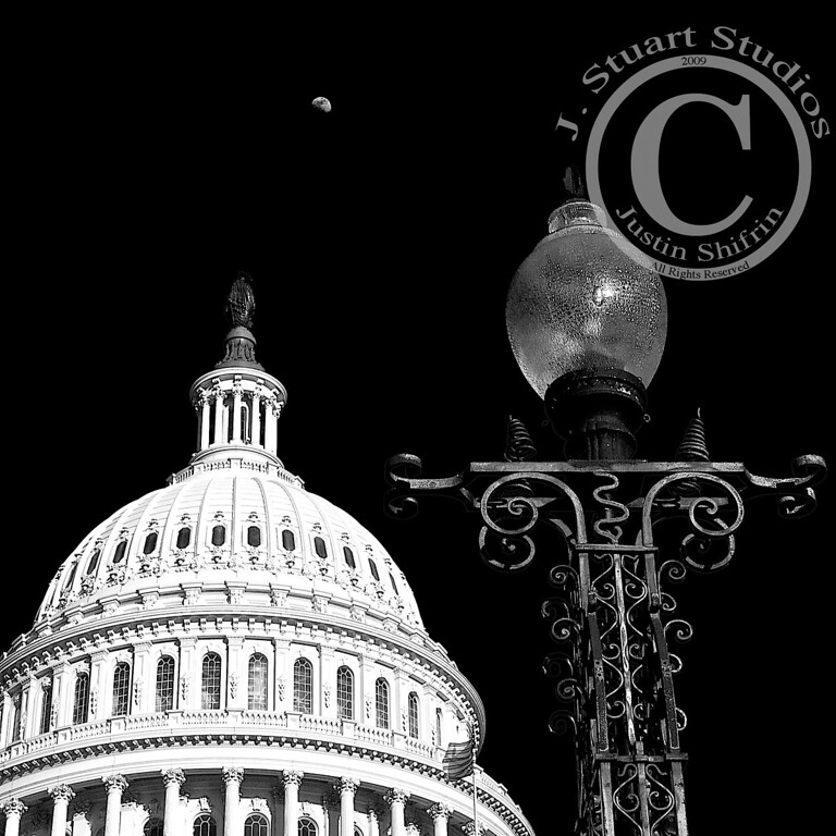 Wrought Rotunda Moonrise<br /> <br /> The United States Capitol Building's rotunda is not often captured in a unique perspective.  However, I photographed the iconic dome as the moon rose high above the capital steps and used this early American wrought iron lamp as the foreground.