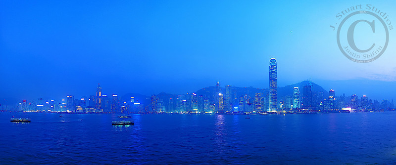 Dewy Victoria Harbour  This panoramic image was taken with long exposures in the evening after the sun set.  The Hong Kong skyline glittered with <i>A Symphony of Lights</i> that evening.