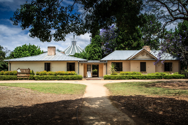 Parramatta, NSW, Australia<br /> Hambledon Cottage, built by John Macarthur as a second house on his Elizabeth Farm Estate. 1824. The building in the background is the 'Our Lady of Lebanon' Maronite church.