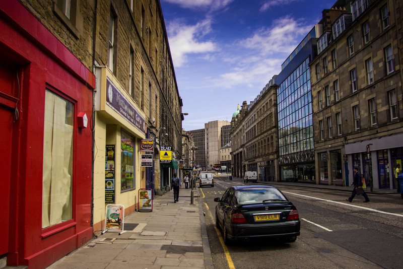 Edinburgh, Scotland<br /> Bread St. At the end (and on the right) is the wonderfully named 'Pubic Triangle' (due to a proliferation of lap-dancing establishments).