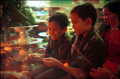 Children Light Incense at Sandhikaram Wat Khmer (Lynn MA)