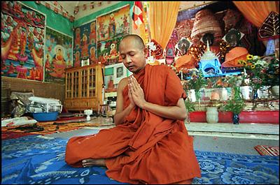 A Monk Prays at Sandhikaram Wat Khmer (Lynn, MA)