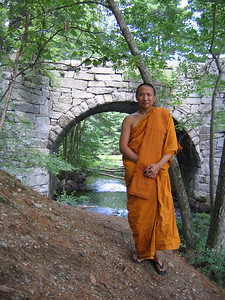 Monk Stands by Wat Buddhabhavana Bridge (Westford, MA)