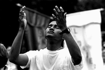 Young Man Raising His Hands in Prayer