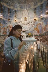 Lighting Votive Candles at Most Holy Redeemer Church (Detroit, MI)