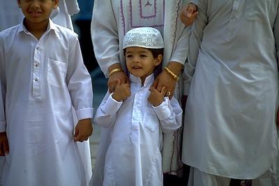 A Young Boy Participating in Eid al-Fitr Festivities (West Palm Beach, FL)