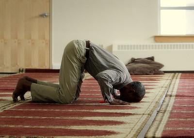 Man kneeling (Boston, MA)