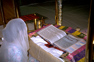 Woman Reading the Guru Granth Sahib at the Sikh Center of Orange County (Santa Ana, CA)