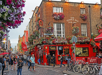 6/24  Dublin, Ireland.  The Temple Bar itself, from which the area takes its name.  Live music, a beer garden, life-size bronze statue of James Joyce, and LOTS of people.