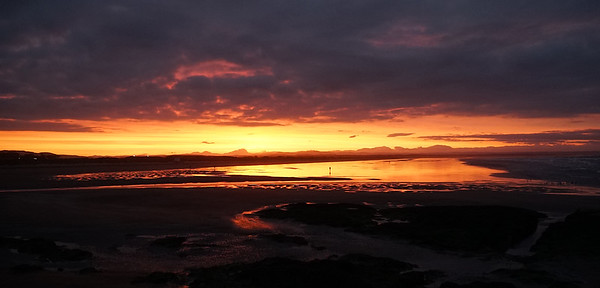 We 6/28  Eastern Scotland.  A 10:04 pm sunset blazes across the wet low-tide beach at the town of St. Andrew's.