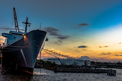 Ship moored at sunset